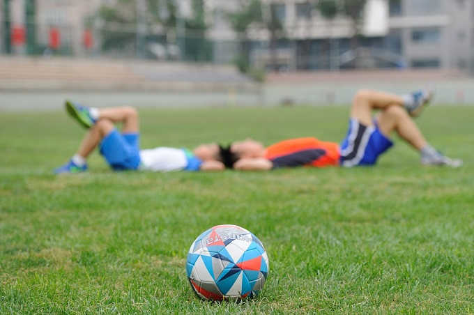 soccer players laid back stock evaluating training effectiveness